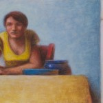 Woman in Yellow Sitting at a Table